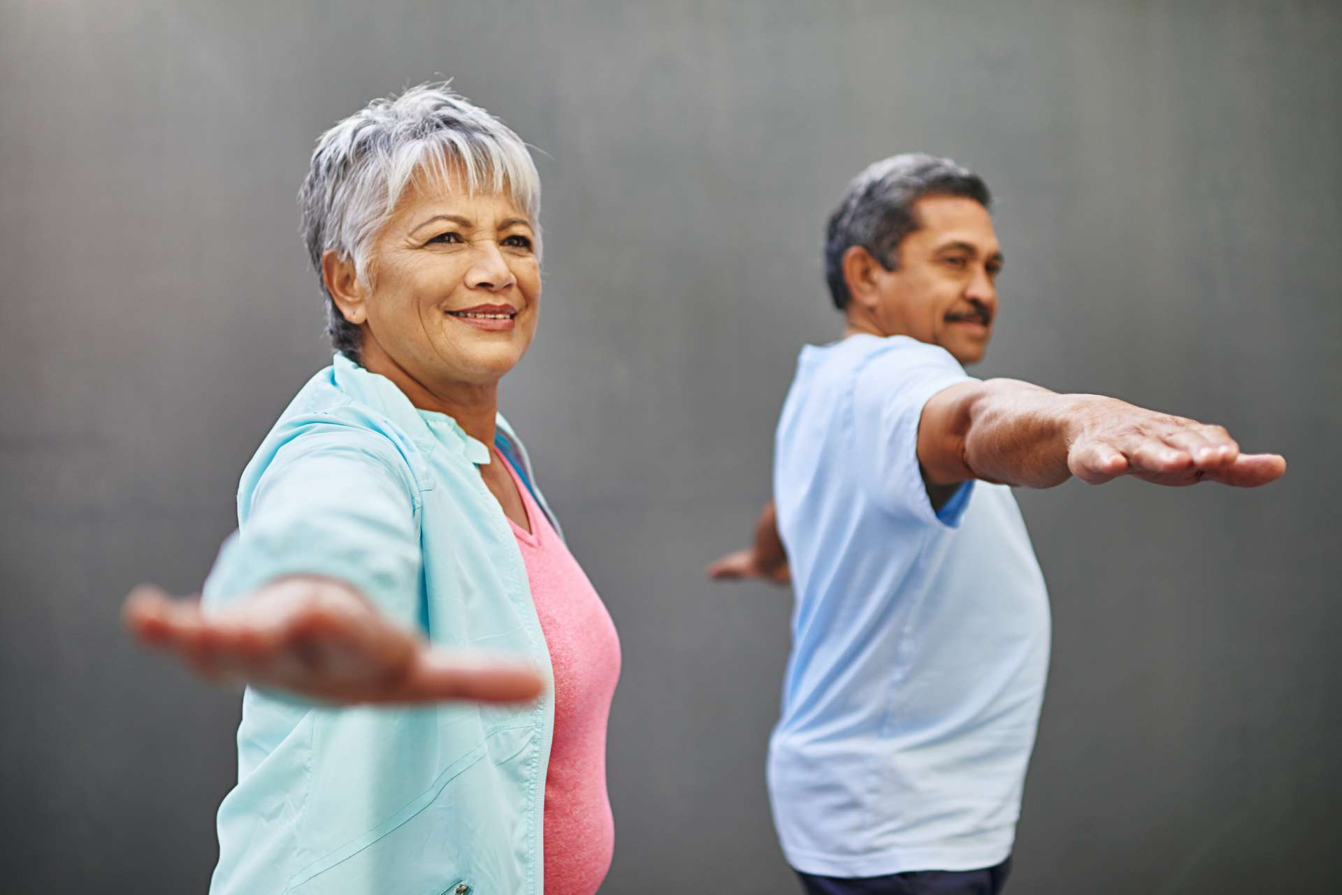 Two seniors exercise